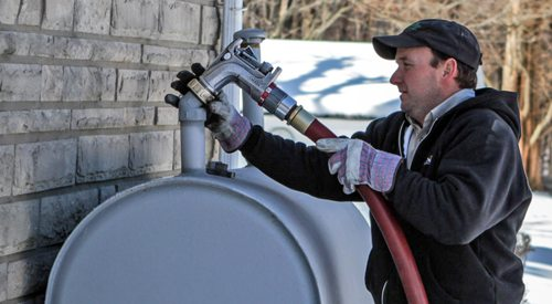 Heating Oil Delivery Driver Filling Fuel Tank.